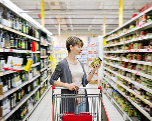 Woman Looking at the nutritional label